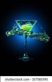 colourful cocktail in glass with splashes and lemon on dark background. Party club entertainment. Mixed light