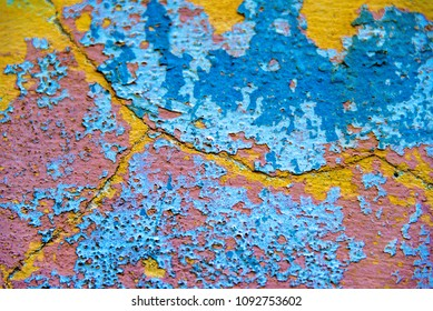 Colourful deteriorated wall: wall belongs to a vintage weathered house. Many heritage building are still standing in Cuba for touristic attraction.