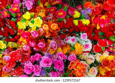 A colourful display of artificial flowers.