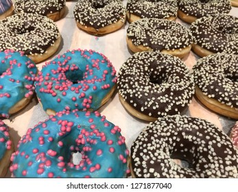 Colourful doughnuts (donuts) pettern. Purple and blue donuts  background