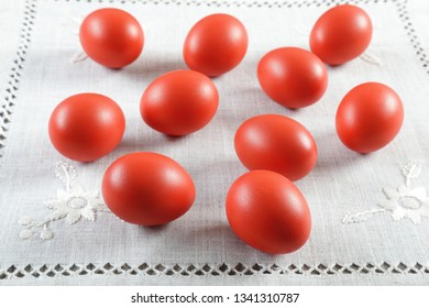 Colourful Easter eggs on ornated linen cloth, closeup shot