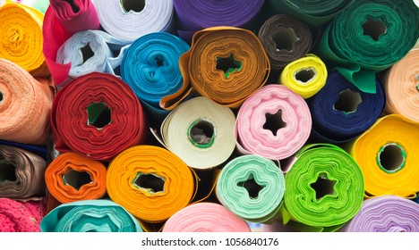 colourful fabric texture for raw mate to make fashion dress. Grossy fabric in favric shop for background