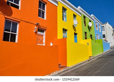 The colourful facades of the houses in Bo Kaap, Cape town.  View of major uphill side street. Cape Town, South Africa - January 23, 2019