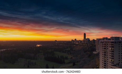 A colourful fall sunset over the Edmonton River Valley with the park and golf course below. The Pearl is visible far in the background. Taken in Edmonton, Alberta, Canada.