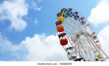 Colourful Ferris wheel against gorgeous blue sky in Spain, Tibidabo, on the outskirts of Barcelona