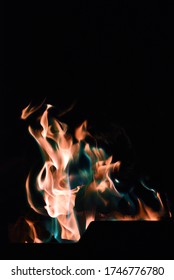 Colourful fire burning at campsite at night