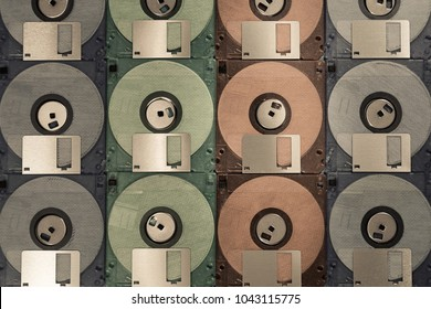 Colourful floppy disks pattern background. Vintage memory technology. Computer data storage in the past.