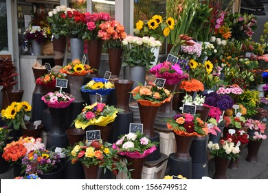Colourful flower stand in market in Vienna, Austria full of bouquets, roses and sunflowers