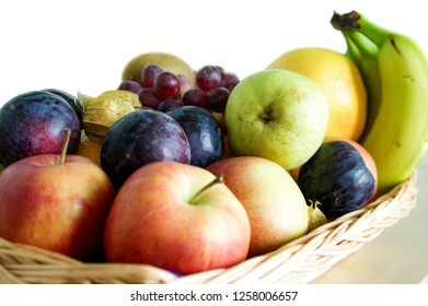 colourful fruits Apple red grapes black graps Orange in a place