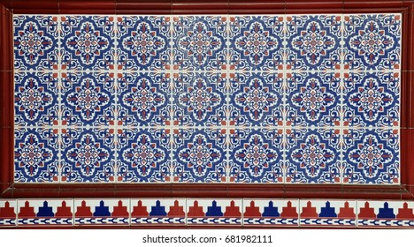 Colourful geometric patterned tiles as found on the facade of traditional peranakan shophouses in Chinatowns throughout Asia