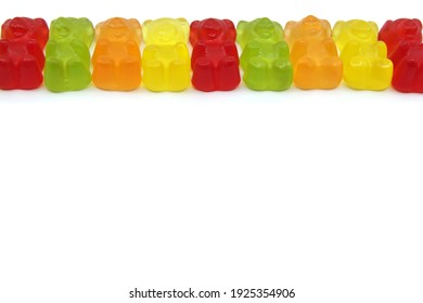 Colourful gummy bears candies isolated on white background. Fun candy macro shot. Copy space for your text.