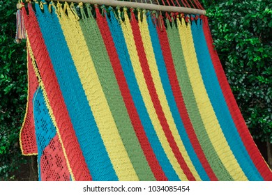 colourful hammock hanging in the garden