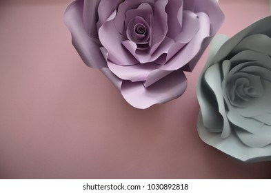 Colourful handmade paper flowers on pink background. Vintage paper flowers. Ultra Violet, Grey,  flowers paper background pattern lovely style. Rose made from paper.