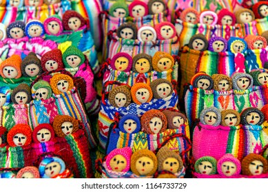 Colourful handmade Peruvian dolls sale in traditional market in the Sacred Valley, Peru.