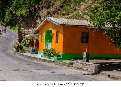 COLOURFUL HOUSES, CHOISEUL, ST LUCIA-10th APRIL 2017:-The Homes in choiseul are painted in bright colours although looking slightly worn.