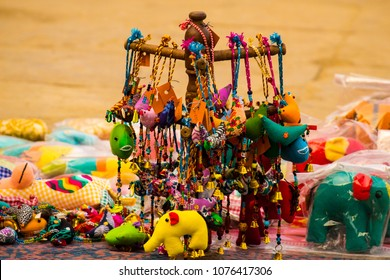 Colourful Indian elephant toys, soft toys and decorative items like bells sold by street vendors in Banaras (Varanasi), India