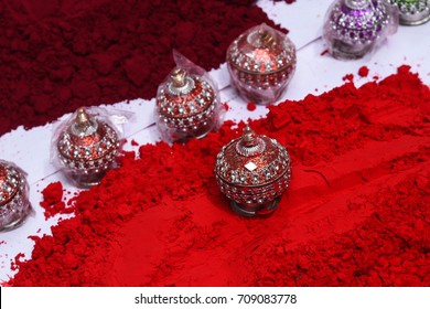 Colourful Indian Lac / Traditional Rajasthani small Sindhoor Boxes decorated with mirror, beads displayed in street shop Udaipur, Rajasthan India. married Indian Hindu women wear vermilion red powder