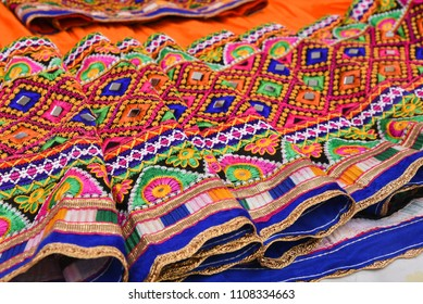 Colourful Indian traditional ethnic ware for woman or girls Gujarat, India. Handmade tribal skirt with embroidery and mirror work. Wedding dress of rural women.
