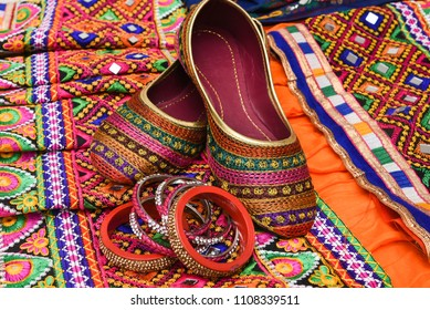 Colourful Indian traditional ethnic ware for woman or girls Gujarat, India. Handmade tribal skirt with embroidery and mirror work and multi color design party wear Rajasthani Mojari or shoes.