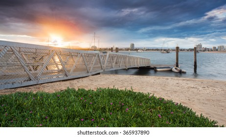 Colourful Landscape View of a Jetty and Boats in the Bay During a Beautiful Sunset, The Spit, Gold Coast, Queensland, Australia
