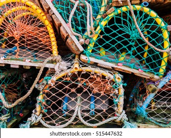 Colourful Lobster pots stucked on each other in a Scottish Fishing village.  Crail, Fife, Scotland, UK