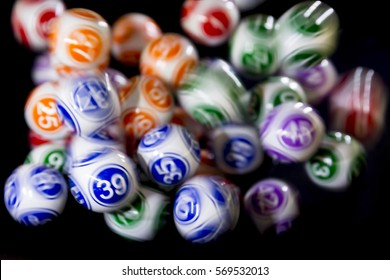 Colourful lottery balls in a bingo machine. Lottery balls in a sphere in motion. Gambling machine and euqipment. Blurred lottery balls in a lotto machine.