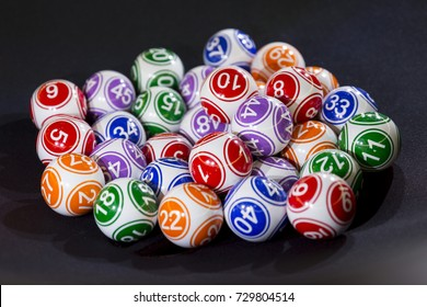 Colourful lottery balls in a bingo machine. Gambling machine and euqipment.
