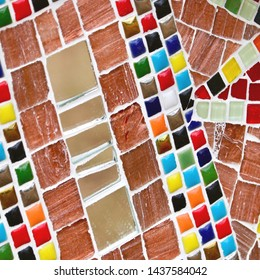 Colourful mosaic tiles and terracotta background haphazard pattern