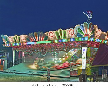 Colourful and moving carousel of a luna park