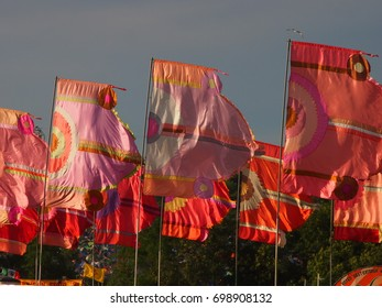 Colourful music festival flags at sunset