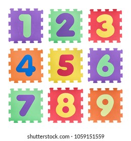 Colourful numbers puzzle set isolated on white background. Number learning block for children education.