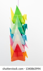 Colourful origami birds against a white background