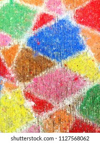 A colourful painted pattern on a  pavement