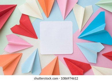 colourful paper airplane and blank white  paper on pastel background. memo,list,organize and air mail concept
