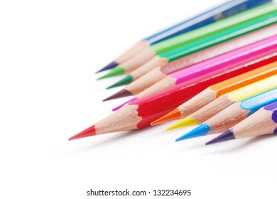 Colourful pencil and one red standing
