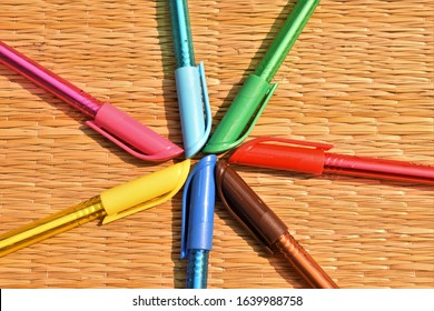 colourful pens arranged in a circle artistically