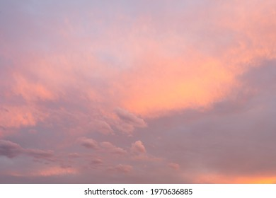Colourful pink sky with clouds at golden hour. Basque Coast of France.