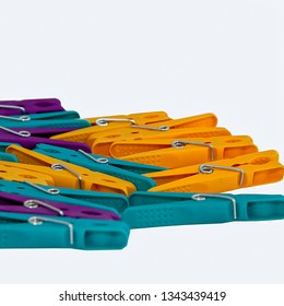 Colourful  plastic clothes pegs on a white background. Stock Image