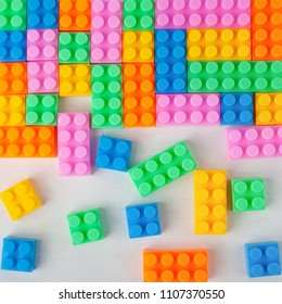 Colourful plastic construction blocks. Top view