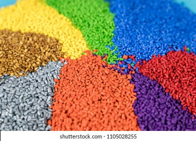 Colourful plastic polymer granules in short depth of field.