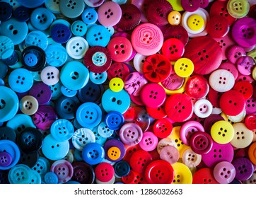 Colourful plastic sewing buttons background