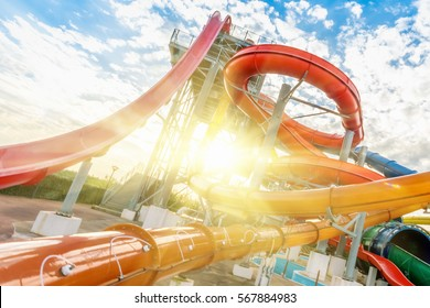 Colourful plastic slides in aquapark in the sunlight