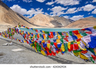 Colourful prayer flags are hanging on the lines in front of Pangong Lake, Leh, Ladakh
