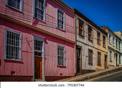 Colourful red, white and yellow buildings on the hilly street in Valparaiso, Chile, South America
