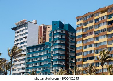 Colourful residential buildings against blue sky at durban beachfront