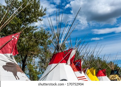 A colourful row of traditional Blackfoot plains Indian tepees in Alberta, North America, at the Calgary Stampede.