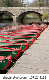 Colourful rowing boats tied up on the River Nidd at Knaresborough, North Yorkshire, England.