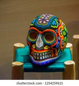Colourful skull from mexican traditional huichol bead. symbol of the day of the dead