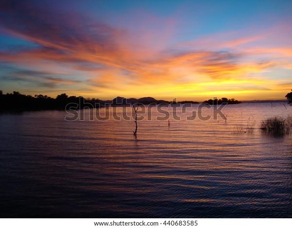 colourful sky over lake