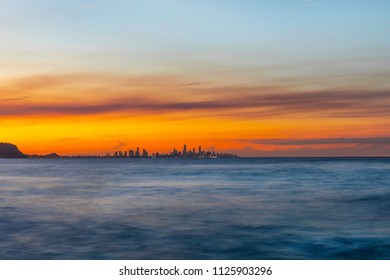 Colourful smokey red sunset in the skies over Surfers Paradise Gold Coast cityscape